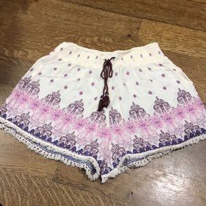 White patterned flowy shorts